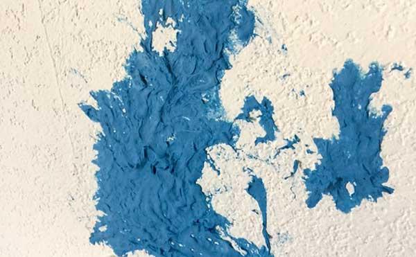 پاک کردن اسلایم از روی دیوار